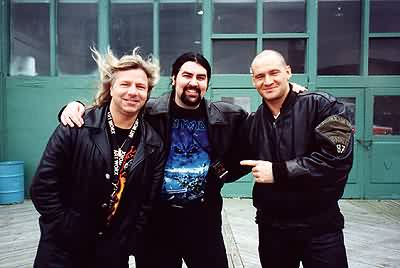 EvilG with Mat and Ralf of Primal Fear. This was taken outside the venue in Asbury Park, NJ, USA in April of 2001. It was the first time that Primal Fear had played in North America.