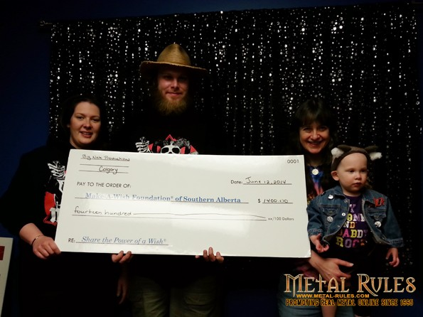 Big Nate and Family with the Big Check. Photo courtesy of Jaelle.