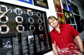 Flemming Rasmussen at the wall in the studio , where there hangs a series of platinum and gold records with Metallica, which he has received . Photo: Bo Svane