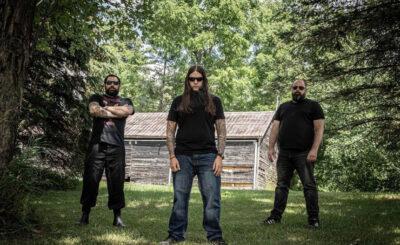 Blood of Christ: L - R: Jason Longo - Drums, Hank Bielanski - Bass & Vocals, Jeff Longo - Guitars Photographer Credit - Debbie Longo